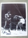 Emile Griffith Former 2 Weight World Champion And Hall Of Famer SIGNED Action Shot Photo Against Benny Kid Paret
