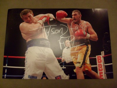 Tyson Fury Undefeated British And Commonwealth Heavyweight Champ SIGNED And INSCRIBED Action Shot Photo From His 2nd Fight Against John McDermott