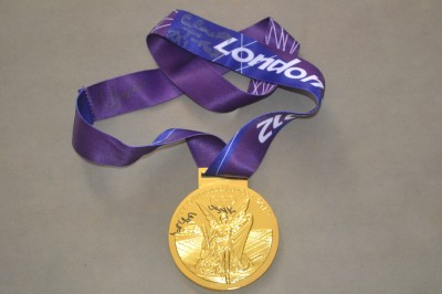 London 2012 Olympic Gold Medallists OLEKSANDR USYK and VASYL LOMACHENKO plus CLARESSA SHIELDS Multi Signed Commemorative Gold Medal
