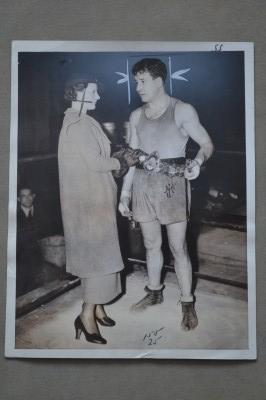 Jock McAvoys Wife Upon Meeting Her Husband In NY Whilst Training For His Fight With Al McCoy Places The Lonsdale Belt Around His Waist Original Photo