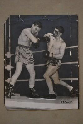 Bruce Woodcoock BATTERED BRUISED and BLOODY Connects With A Right Cross Against Lee Savold Original 1950 Press Photo